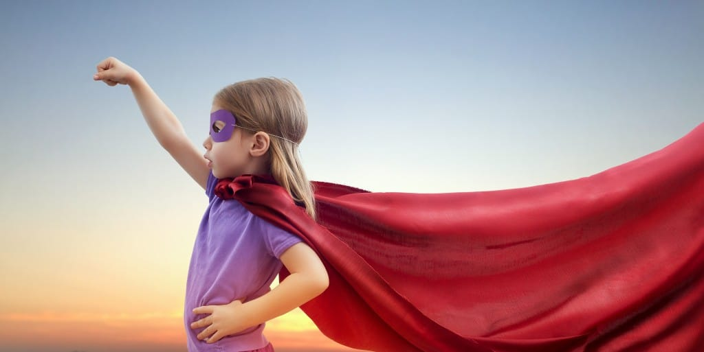 a little girl plays superhero